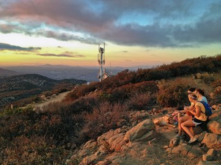 Female Hikers enjoying a Sunset over San Diego, California