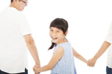 happy little girl hold parents hands and smiling .