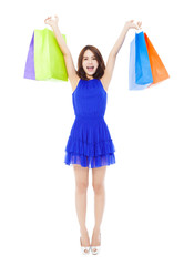 beautiful young woman with shopping bags.