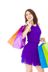 smiling young woman holding shopping bag