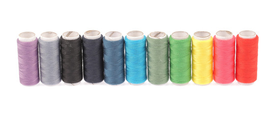 Spools of colours threads isolated on white background