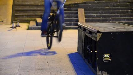 bicycle driver slide on edge of ledge box