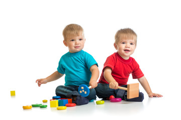 Happy kids playing wooden toys together