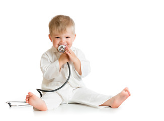 Funny kid playing doctor with stethoscope isolated