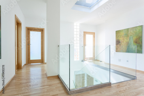 Stairs, glass banister and doors in modern hallway - 70418378