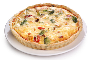 Quiche with broccoli and vegetables on a white plate.