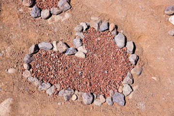 Heart made of stones on beach