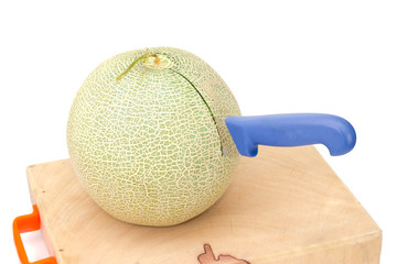 Separate melon on the cutting board