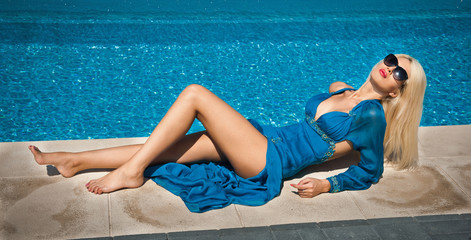 Beautiful sensual blonde with fashionable sunglasses relaxing