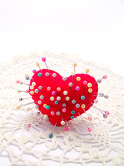heart with straight pin on white background