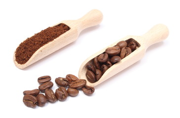 Brown coffee on wooden spoon. White background