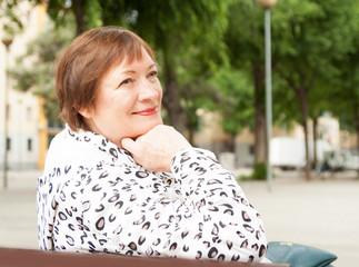 mature woman at european town street