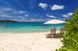 Leinwanddruck Bild - Chairs and umbrella on a beautiful tropical beach of Seychelles
