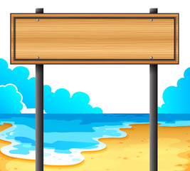 An empty wooden signboard at the beach