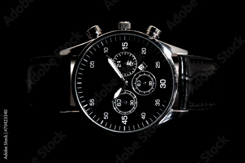 modern watch isolated on a black background - 70423340