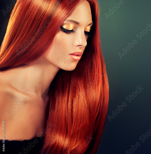 Beautiful model with long red hair