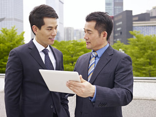 asian businesspeople discussing business outdoor