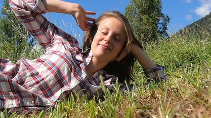 young farm girl lying in a field