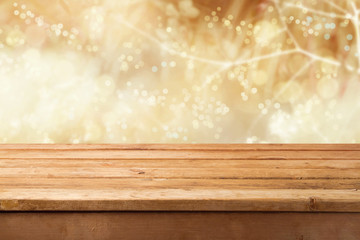 Golden bokeh background with empty wooden table