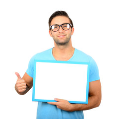 Happy young man showing and displaying blank board with thumb up