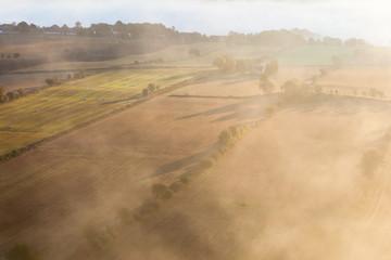 View of rural landscape in fog