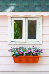 Window and bouquet of flower