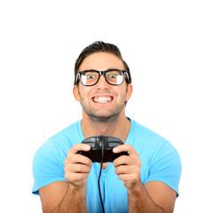 Portrait of handsome man holding joystick for video games agains