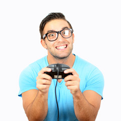 Portrait of handsome man holding joystick for video games agains