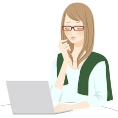 PC操作をする困る女性 メガネ
