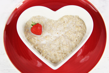 Healthy breakfast  of strawberry porridge / oatmeal.
