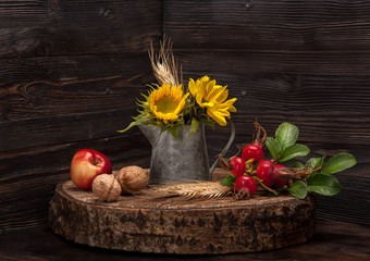 Sunflower, wild rose, apple and walnuts . Autumn Still Life