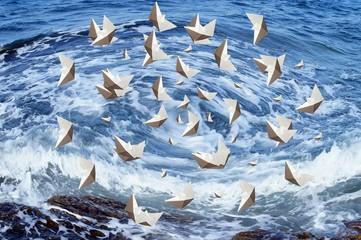 Barche in un vortice d'acqua