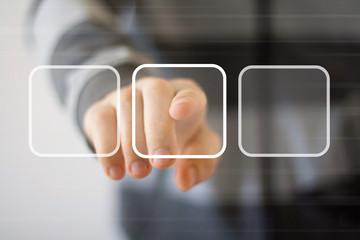 Businessman touching digital interface buttons