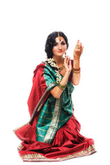 Beautiful young indian woman in traditional clothing, isolated
