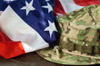 US flag with camouflage combat hat