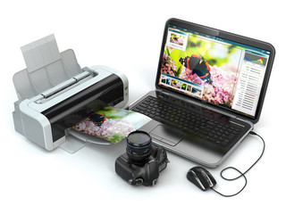 Laptop, photo camera and printer. Preparing images for print.
