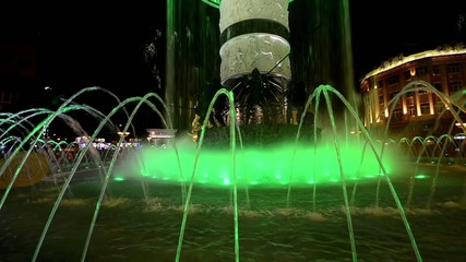 Abstract lit water fountain background of dancing forms