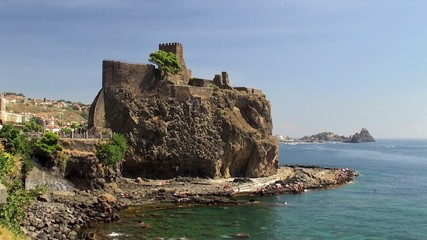 Norman Castle  on the rocky waterfront at Aci Castello