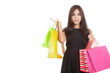 Asian woman  present something  with shopping bags