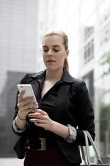 Young business woman speaking on mobile phone