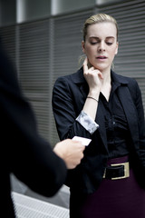 Business woman looking at business card