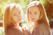 Twins. A group of young beautiful girls. Two women face close-up