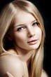 Woman face close up. A pretty young blond trendy. Girl with a be