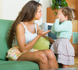 Woman scolding child at home