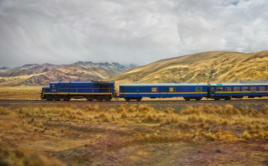 Passenger train in the entrance to  La Raya and Pukara, Puno, Pe