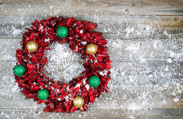 Natural leaf wreath with ornaments and snow for the seasonal hol