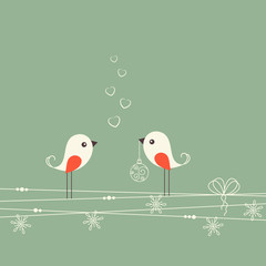 Two cute birds with Christmas decorations