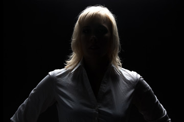 Businesswoman in shadow looking at camera