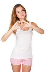 Beautiful girl shows a heart symbol