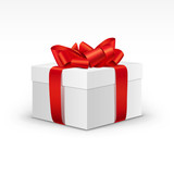 Photo: White Gift Box with Bright Red Ribbon Isolated